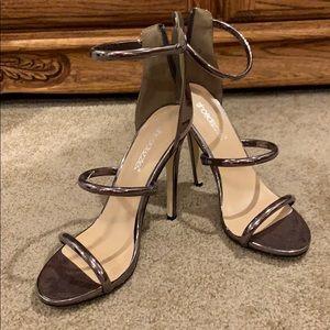Metallic silver heels size 7.5